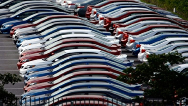 Asian investors shift cautiously, autos hit by US tariff threat