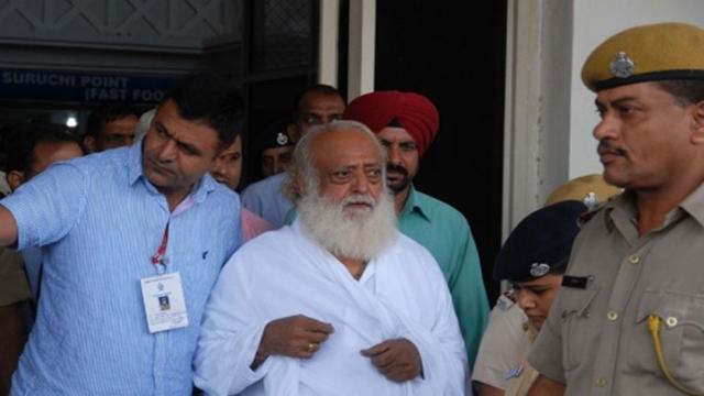 Indian court jails popular guru for life for teen rape