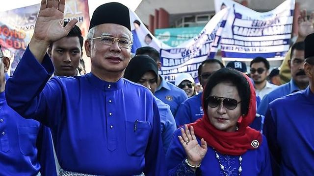 Malaysia bars Najib and wife from leaving country