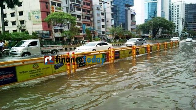 Heavy rains leave Dhaka streets flooded on Sunday. Photo: Nirmal Barman